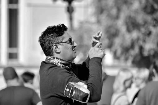 asian handsome eyeglasses side street portrait hands outdoors