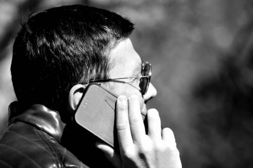 phone ear hand mobile profile side telephone telecommunication businessman businessperson