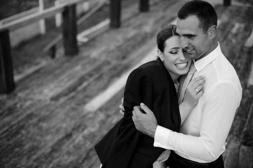 romance togetherness businesswoman businessman hugging affection outdoors couple