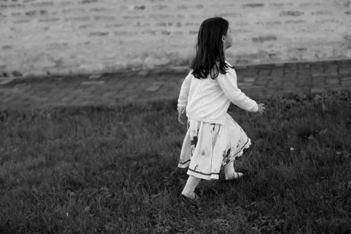 walking child leisure grassy dress grass pretty summer