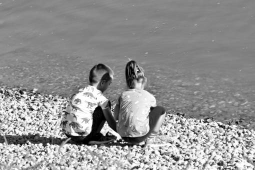 beach brother sister child fun childhood parent water sand