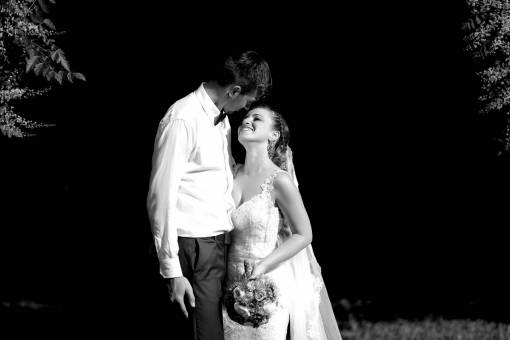 dress smiling groom shadow couple embrace bride wedding forest