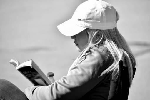 enjoyment reading outdoors gorgeous blonde hair hat portrait woman