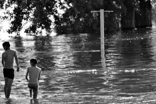 swimsuit lakeside boys lake water recreation flood landscape child shore swimming jumping jump splash wet  boy children
