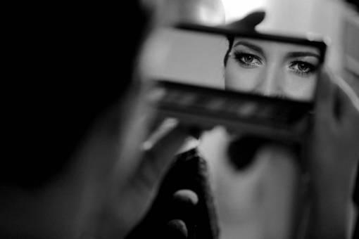 woman reflection mirror eyes beautician cosmetics young beauty makeup