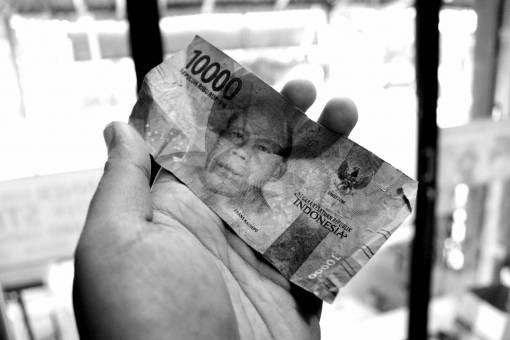 money  rupiah  hand  hold  poor  indonesia