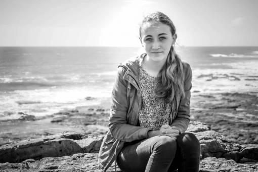 sea  rock  person  black and white  girl