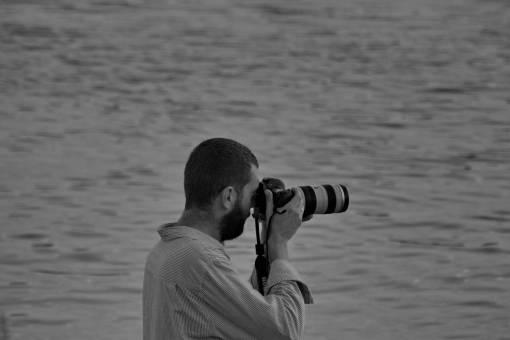 horizon lens photographer camera water leisure device outdoors nature