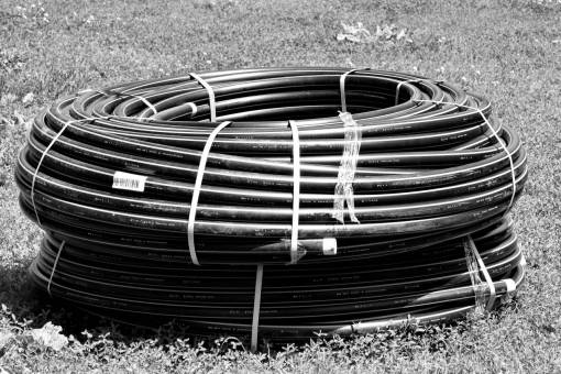 industrial pipe grassland meadow pipeline plastic piping outdoors grass object