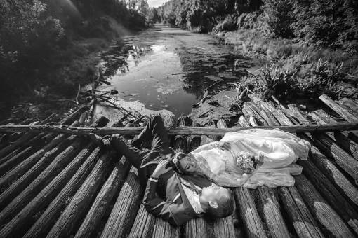 bridge wooden swamp bride professional wedding photography groom wood water