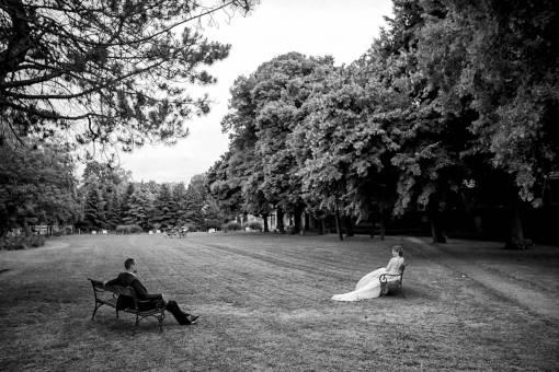 distance man social woman isolation park tree conversation grass bench self