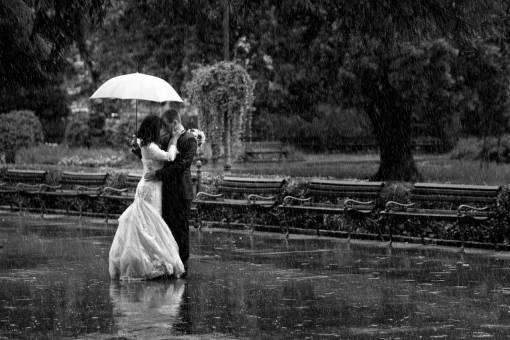 street pretty umbrella enjoying groom happiness bride rain
